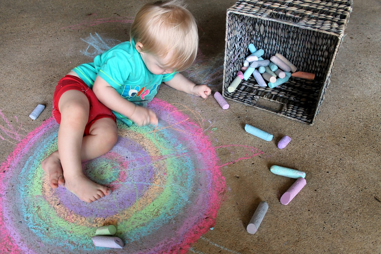 Let your child play with chalk and other art supplies to encourage creativity.